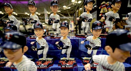 Dozens of Joe Mauer bobble heads wait for prospective buyers at the 2014 MLB All-Star FanFest at the Minneapolis Convention Center on Friday, July 11, 2014. (Pioneer Press: John Autey) via twincities.com